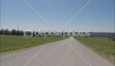 POV Driving on asphalt country road, the camera in front, summer — Stock Video