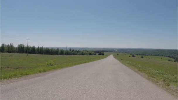 POV Driving on asphalt country road, the camera in front, summer — Vidéo