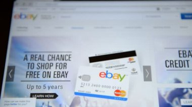 A woman with a tablet makes a purchase on ebay — Stock Video