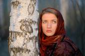 Russian girl in a scarf in a birch forest, close-up — Stock Photo