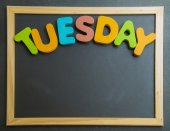 Colorful wooden word Tuesday on black board — Foto de Stock