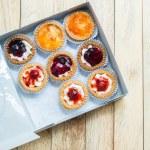 Variety fruit tart in paper box 2 — Stock Photo #67487519