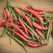 Red and Green chilli pepper on chopping block 2 — Stock Photo #72397217