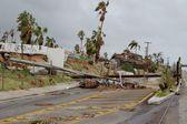 Broken by hurricane electric wooden post — Stock Photo