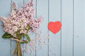 Red heart and flowers — Stock Photo