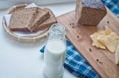 Milk, cheese and rye bread — Stock Photo