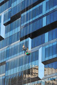 New business building and window cleaners — Stock Photo