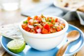Tomato salsa with tortilla and toast — Stock Photo