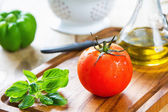 Tomato,Basil and Bell pepper on chopping board — Stock Photo
