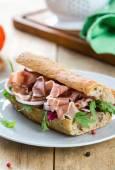 Prosciutto with rocket and radicchio sandwich  — Stock Photo