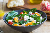 Orange with spinach, pomegranate and feta cheese salad — Stock Photo