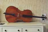 Wooden violoncello in room — Stock Photo