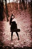 Mademoiselle in Bois de Boulogne Paris, Violinist girl in little black dress — Stock Photo