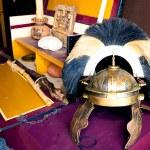 Постер, плакат: Rich Roman helmet on working desk