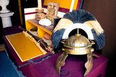 Rich Roman helmet on working desk — Stock Photo