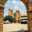 Unidentified people on square in front of church in Famagusta, Northern Cyprus — Stock Photo #56975213