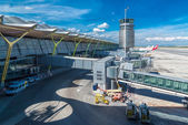 Flight tower with parked planes on Adolfo Suarez Madrid Barajas Airport — Stock Photo