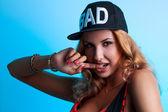 Portrait of sexual seductive female in black hat on blue backgro — Stock Photo