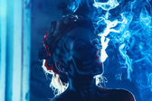 Face art of skull on woman face with smoke — Stock Photo