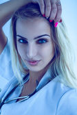 Cold tones portrait of sexual nurse with stethoscope — Stock Photo