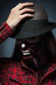Attractive adult woman with scary halloween style make up lookin — Stock Photo