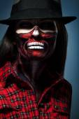 Halloween portrait of woman with face art — Stock Photo