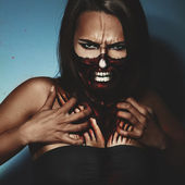 Halloween style photo of woman with fac and body art — Stock Photo