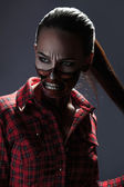 Vertical photo of adult girl with scary halloween style face art — Stock Photo