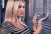 Gorgeous white hair woman with brown eyes looking at window — Foto de Stock