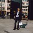 Square full length photo of business man in trendy suit outdoors — Stock Photo #65524165