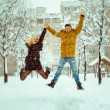 Couple in love having fun and jump in the snow — Stock Photo #66824637