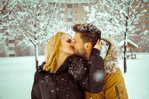 Outdoors color photo of couple in love kissings — Stock Photo