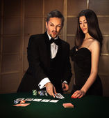 Square photo of sexual couple in elegant suit to play poker — Stock Photo