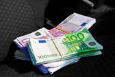 Macro photo of a pack of money EUR on a car seat — Stock Photo