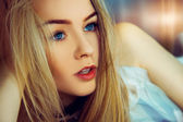 Indoors portrait of beauty young woman with blue eyes — Stock Photo