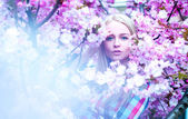 Lady with flowers looking at camera. Spring time — Stock Photo