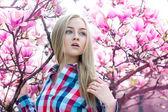Sensitive beautiful girl near blossoming pink tree — Stock Photo