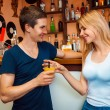 Boy meets a girl and treat her cocktail in the bar — Stock Photo #74069259
