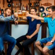 Group of guys drinking beer in a bar and have some fun — Stock Photo #74069635