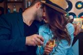 Elegant male kiss girlfriend in cheeks — Stock Photo