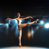 Sweet blonde ballerina on stage in theater posing — Stock Photo