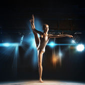 Full length photo of ballet dancer posing in theater — Стоковое фото