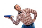 Adult male hipster presents a book and smiling — Stock Photo