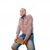 Nerd guy carries heavy burden of knowledge in form of books — ストック写真
