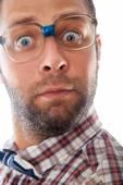 Close up portrait of surprised elegant geek in glasses — Stock Photo