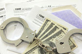 Tax papers with dollar bills and handcuffs — Foto de Stock