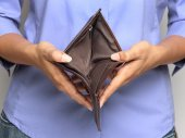 Person holding an empty wallet - showing bankruptcy — Foto de Stock