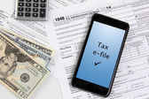 Filing taxes using a mobile phone — Stock Photo