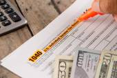 Person filing federal income tax form 1040 — Stock Photo