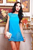 Beautiful brunette woman in summer dress — Stock Photo